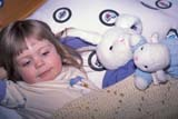 EVE EAS MIS  SK  CWN2202016D  MR #354   GIRL WITH STUFFED ANIMALS LAYING IN BEDSASKATOON                       03/30© CLARENCE W. NORRIS      ALL RIGHTS RESERVEDANIMALS;BEDTIME;BUNNIES;CHILDREN;EASTER;EVENTS;GIRL;LAMBS;MR_;PEOPLE;PLAINS;PRAIRIES;RABBITS;SASKATCHEWAN;SASKATOON;SK_;SLEEPING;TOYSLONE PINE PHOTO              (306) 683-0889