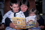 EVE EAS MIS  SK  CWN2202019D  MR #354   MOM READING EASTER BOOK TO CHILDRENSASKATOON                       03/30© CLARENCE W. NORRIS      ALL RIGHTS RESERVEDADULTS;BOY;CHILDREN;EASTER;EVENTS;FAMILIES;FEMALE;GIRL;MR_;PARENTS;PEOPLE;PLAINS;PRAIRIES;READING;SASKATCHEWAN;SASKATOON;SK_LONE PINE PHOTO              (306) 683-0889