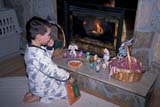 EVE EAS MIS  SK  CWN2202024D  MR #354   BOY PLACING CARROTS ON HEARTHSASKATOON                       03/30© CLARENCE W. NORRIS      ALL RIGHTS RESERVEDBOY;CARROTS;CHILDREN;DECORATIONS;EASTER;EVENTS;FIREPLACES;FOOD;MR_;PEOPLE;PLAINS;PRAIRIES;SASKATCHEWAN;SASKATOON;SK_LONE PINE PHOTO              (306) 683-0889