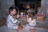 EVE EAS MIS  SK  CWN2202025D  MR #354   BOY AND GIRL PLACING CARROTS ON HEARTHSASKATOON                       03/30© CLARENCE W. NORRIS      ALL RIGHTS RESERVEDCARROTS;CHILDREN;CO_ED;DECORATIONS;EASTER;EVENTS;FIREPLACES;FOOD;MR_;PEOPLE;PLAINS;PRAIRIES;SASKATCHEWAN;SASKATOON;SK_LONE PINE PHOTO              (306) 683-0889