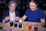 EVE EAS MIS  SK  CWN2202112D  MR  GIRL AND GRANDMOTHER COLOURING EASTER EGGSSASKATOON                       03/31© CLARENCE W. NORRIS      ALL RIGHTS RESERVEDCRAFTS;DYE;EASTER;EGGS;EVENTS;FAMILIES;FEMALE;GRANDPARENTS;JENNIE;MR_;PEGGY;PEOPLE;PLAINS;PRAIRIES;SASKATCHEWAN;SASKATOON;SENIORS;SK_;TEENSLONE PINE PHOTO              (306) 683-0889