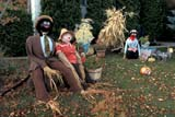EVE HAL MIS  SK     1516015AD HALLOWE'EN MAN AND WOMAN ON FRONT LAWNSASKATOON                       10/08© CLARENCE W. NORRIS      ALL RIGHTS RESERVEDAUTUMN;COUPLE;DECORATIONS;EVENTS;HALLOWEEN;PLAINS;PRAIRIES;SASKATCHEWAN;SASKATOON;SK_LONE PINE PHOTO              (306) 683-0889