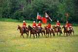 EVE RCM MAR  SK     1906501D  MRTROOP RIDING THROUGH MEADOWNWMP MARCH WESTDUCK LAKE                          06/..© CLARENCE W. NORRIS      ALL RIGHTS RESERVEDANIMALS;DUCK_LAKE;EVENTS;FLAGS;HORSES;MEADOWS;MR_;NWMP;NWMP_MARCH_WEST;PEOPLE;PLAINS;PRAIRIES;SASKATCHEWAN;SK_;WESTERNLONE PINE PHOTO              (306) 683-0889