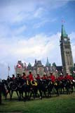 EVE RCM MUS  ON  DSR1000758D  VT RCMP MUSICAL RIDE, PARLIAMENT HILLOTTAWA                           0723© DUANE S. RADFORD        ALL RIGHTS RESERVEDANIMALS;BUILDINGS;BULLETINS;CANADIAN;CAPITAL;CENTRAL;EVENTS;GROUP;HORSES;ON_;ONTARIO;PARLIAMENT;PARLIAMENT_HILL;PEOPLE;POLICE;RCMP;STRUCTURES;TEAMWORK;TOURISM;UNIFORMS;VTLLONE PINE PHOTO                  (306) 683-0889