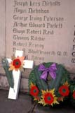 EVE REM DAY  SK     1813507D  VTCROSS AND WREATH BY MEMORIAL REMEMBRANCE DAYSASKATOON                       11/11© CLARENCE W. NORRIS      ALL RIGHTS RESERVEDBULLETINS;CROSSES;EVENTS;PLAINS;POPPIES;PRAIRIES;REMEMBRANCE_DAY;SASKATCHEWAN;SASKATOON;SK_;VTL;WINTER;WREATHSLONE PINE PHOTO              (306) 683-0889