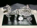 EVE WED MIS  BC  CWN02D2609D HORSE AND COACH DECORATION ON WEDDING CAKESALMON ARM                          08/. .© CLARENCE W. NORRIS          ALL RIGHTS RESERVEDBC_;BRITISH;BRITISH_COLUMBIA;COLUMBIA;CARRIAGES;COACHES;CORDILLERA;DECORATIONS;EVENTS;GLASS;HORSES;SALMON_ARM;WEDDINGSLONE PINE PHOTO                  (306) 683-0889