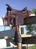 FAR LIV HOR  SK  CWN02D03465D  VT    SADDLE ON FENCE MEACHAM                               09/. .© CLARENCE W. NORRIS          ALL RIGHTS RESERVEDANIMALS;FARMING;HORSES;LIVESTOCK;MEACHAM;PLAINS;PRAIRIES;RURAL;SADDLES;SASKATCHEWAN;SCENES;SK_;VTLLONE PINE PHOTO                  (306) 683-0889