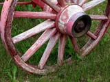 FAR SCE MIS  SK  CWN02D1625D   OLD RED WAGON WHEELELSTOW                                 0730© CLARENCE W NORRIS           ALL RIGHTS RESERVEDELSTOW;FARMING;PIONEERS;PLAINS;PRAIRIES;RURAL;RUSTIC;SASKATCHEWAN;SCENES;SK_;WAGONS;WHEELSLONE PINE PHOTO                  (306) 683-0889.