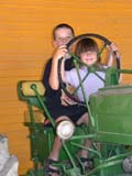 FAR PEO MIS  BC  CWN02D2333D  NMR  VTCHILDREN PLAYING ON TRACTOR, DE MILLE'S  MARKET GARDENSALMON ARM                          08..© CLARENCE W NORRIS           ALL RIGHTS RESERVEDBC_;BOY;BRITISH;BRITISH_COLUMBIA;CHILDREN;COLUMBIA;FARMING;GIRL;INTERIOR;OKANAGAN_VALLEY;RURAL;SCENES;TRACTORS;VTLLONE PINE PHOTO                  (306) 683-0889.