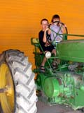 FAR PEO MIS  BC  CWN02D2334D      NMR  VTCHILDREN PLAYING ON TRACTOR, DE MILLE'S  MARKET GARDENSALMON ARM                          08..© CLARENCE W NORRIS           ALL RIGHTS RESERVEDBC_;BOY;BRITISH;BRITISH_COLUMBIA;CHILDREN;COLUMBIA;FARMING;GIRL;INTERIOR;OKANAGAN_VALLEY;RURAL;SCENES;TRACTORS;VTLLONE PINE PHOTO                  (306) 683-0889.