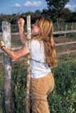 FAR PEO MIS  SK     1911404D  MR  VT  GIRL HOOKING GATEMEADOW LAKE                   08..© CLARENCE W. NORRIS      ALL RIGHTS RESERVEDBARBED_WIRE;FARMING;FEMALE;FENCES;MEADOW_LAKE;MR_;PEOPLE;PLAINS_PRAIRIES;RURAL;SASKATCHEWAN;SCENES;SK_;TEENS;VTLLONE PINE PHOTO              (306) 683-0889