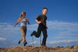 FAR PEO MIS  SK     1911411D  MRBOY AND GIRL RUNNING ON HAY BALESMEADOW LAKE                    08..© CLARENCE W. NORRIS       ALL RIGHTS RESERVEDBOY;CHILDREN;FARMING;FEMALE;FUN;GIRL;MEADOW_LAKE;MR_;OUTDOORS;PEOPLE;PLAINS;PRAIRIES;RUNNING;RURAL;SASKATCHEWAN;SCENES;SK_TEENSLONE PINE PHOTO                  (306) 683-0889