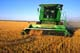JOHN DEERE COMBINE IN FIELD, WARMAN