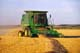 JOHN DEERE COMBINE IN FIELD AT HARVEST, WARMAN