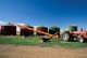 TRACTOR AND AUGER AT GRAIN BINS, ASQUITH