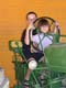 CHILDREN PLAYING ON TRACTOR, SALMON ARM