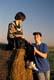 TEENAGE BOY AND GIRL VISITING AT HAY BALE, OSLER