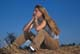 GIRL SITTING ON HAY BALES, MEADOW LAKE