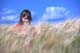 GIRL IN BUMPER BARLEY CROP, HUDSON BAY