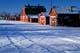 RED BARN AND OUTBUILDINGS IN WINTER, WAKAW
