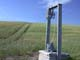 WATER WELL & TRAIL LEADING THROUGH FIELD, ST. DENIS