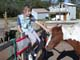 GIRL PETTING  HORSE IN CORRAL, MEACHAM