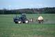 FARMER ON FORD TRACTOR SPRAYING SPRING CROP, SASKATOON