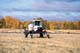 FARMER SPRAYING IN FALL WITH SPRA-COUPE, SMEATON