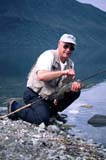 FIS GRA ARC  YT  DSR0304002DX  MR  VTFISHERMAN HOLDING ARCTIC GRAYLINGDISPLAYING DORSAL FIN (DUANE RADFORD)TINCUP LAKE WILDERNESS LODGE    0719© DUANE S. RADFORD             ALL RIGHTS RESERVEDARCTIC_GRAYLING;CORDILLERA;FISH;FISHING;MALE;MR_;OUTDOORS;PEOPLE;SPORTS;SUMMER;TINCUP_LAKE_WILDERNESS_LODGE;VTL;YT_;YUKONLONE PINE PHOTO                  (306) 683-0889