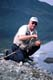 FISHERMAN HOLDING ARCTIC GRAYLING, TINCUP LAKE WILDERNESS LODGE
