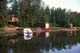 CABIN AND BOAT ON LAKE FRONT IN EARLY MORNING, ECHO BAY, BIG SHELL LAKE