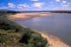 SANDY SHORELINE OF SOUTH SASKATCHEWAN RIVER IN SUMMER, LEADER