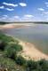 SANDY SHORELINE OF SOUTH SASKATCHEWAN RIVER IN SUMMER, LEADER