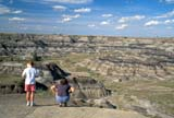 GEO BAD MIS  AB  CWN2206723D  PEOPLE VIEWING HORSESHOES CANYONDRUMHELLER                       08..© CLARENCE W. NORRIS      ALL RIGHTS RESERVEDAB_;ALBERTA;BADLANDS;DRUMHELLER;EROSION;FEMALE;GEOGRAPHY;HIKING;HORSESHOE_CANYON;OUTDOORS;PEOPLE;PLAINS;PRAIRIES;SCALE;SCENES;SUMMER LONE PINE PHOTO              (306) 683-0889