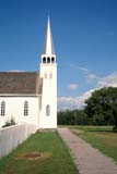 HIS NAT BAT  SK     2006421D  VTSIDEWALK, FENCE AND CHURCHBATOCHE NAT HIS. SITE       08/03© CLARENCE W. NORRIS      ALL RIGHTS RESERVEDBATOCHE;BATOCHE_NHS;BOARDWALKS;BUILDINGS;BULLETINS;CATHOLIC;CHURCHES;FENCES;HISTORIC;METIS;PIONEERS;PLAINS;PRAIRIES;RELIGION;SASKATCHEWAN;SIDEWALKS;SK_;STRUCTURES;SUMMER;TOURISM;VTL;WOODLONE PINE PHOTO              (306) 683-0889
