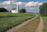 HIS NAT BAT  SK     2006703DROAD LEADING TO CHURCHBATOCHE NAT HIS. SITE       08/03© CLARENCE W. NORRIS      ALL RIGHTS RESERVEDBATOCHE;BATOCHE_NHS;BUILDINGS;CATHOLIC;CHURCHES;CLOUDS;CROSSES;HISTORIC;METIS;PIONEERS;PLAINS;PRAIRIES;RELIGION;ROADS;SASKATCHEWAN;SK_;SKY;STRUCTURES;SUMMER;TOURISMLONE PINE PHOTO              (306) 683-0889