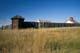 EXTERIOR VIEW OF STOCKADE ON GRASSLANDS, FORT BATTLEFORD NATIONAL HISTORIC SITE