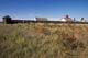 EXTERIOR VIEW OF FORT SEEN ACROSS GRASSLANDS, FORT BATTLEFORD NATIONAL HISTORIC SITE