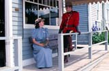 PAR HIS HER  AB     1115322D  NMR  RCMP OFFICER TALKING TO PIONEER WOMANHERITAGE PARKCALGARY                              0731© CLARENCE W. NORRIS        ALL RIGHTS RESERVED  AB_;ALBERTA;CALGARY;COUPLE;FEMALE;HERITAGE_PARK;HISTORIC;MALE;PEOPLE;PIONEERS;PLAINS;PRAIRIES;RCMP;VERANDASLONE PINE PHOTO                (306) 683-0889