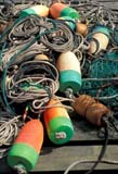 IND FIS MIS  ME  LDL1000238D  VTCOLORFUL FISHING BUOYS ON ROPES ON DOCKBERNARD                               ....© L. DIANE LACKIE                 ALL RIGHTS RESERVEDATLANTIC;BERNARD;BULLETINS;BUOYS;FISHING;HARBOURS;INDUSTRY;MAINE;MARITIMES;ROPES;USA;VTLLONE PINE PHOTO              (306) 683-0889