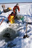 IND FIS MIS  AB  DSR1001239D  VT MEN PULLING GILL NET IN WINTERLAC STE. ANNE                    03/..© DUANE S. RADFORD         ALL RIGHTS RESERVEDAB_;ALBERTA;COMMERCIAL_FISHING;FISHING;ICE;ICE_FISHING;INDUSTRY;LAC_STE_ANNE;MALE;NETS;OCCUPATIONS;OUTDOORS;PEOPLE;VTL;WINTERLONE PINE PHOTO              (306) 683-0889