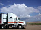 IND TRU MIS  SK  CWN02D2766D   TRACTOR TRUCK AND CLOUDSROSETOWN                            08/. .© CLARENCE W. NORRIS          ALL RIGHTS RESERVEDAUTOS;AUTUMN;HIGHWAYS;INDUSTRY;OCCUPATIONS;PLAINS;PRAIRIES;ROADS;ROSETOWN;SASKATCHEWAN;SEMI;SEMI_TRAILER;SK_;TRACTORS;TRACTOR_TRAILERS;TRAILERS;TRANSPORTATION;TRUCKINGLONE PINE PHOTO                  (306) 683-0889