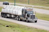 IND TRU MIS  SK  WDS06G0850DXTRANSPORT TRUCK ON HIGHWAYSASKATOON                       09/23© WAYNE SHIELS                ALL RIGHTS RESERVEDAUTOS;AUTUMN;HIGHWAYS;INDUSTRY;OCCUPATIONS;PLAINS;PRAIRIES;ROADS;SASKATCHEWAN;SASKATOON;SEMI;SEMI_TRAILER;SK_;TRACTORS;TRACTOR_TRAILERS;TRAILERS;TRANSPORTATION;TRUCKINGLONE PINE PHOTO              (306) 683-0889