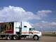 TRACTOR TRUCK AND CLOUDS, ROSETOWN