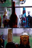 ART MIS MIS  ON  BMM1000139D  VTOLD BOTTLES IN WINDOWPORT CARLING                               07© BEV MCMULLEN                          ALL RIGHTS RESERVEDANTIQUES;ART;BOTTLES;CENTRAL;COLLECTIBLES;CONTAINERS;GLASS;ON_;ONTARIO;PORT_CARLING;STILL_LIFE;SUMMER;VTLLONE PINE PHOTO              (306) 683-0889
