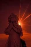 ART SCU MIS  NY  BMM1000701D  VTSTONE ANGEL AT SUNSETMOUNT HOPE CEMETERYROCHESTER                                  06© BEV MCMULLEN                         ALL RIGHTS RESERVEDANGELS;ART;CEMETERIES;MOUNT_HOPE_CEMETERY;NEW_YORK;ROCHESTER;SCULPTURES;STONE;SUMMER;SUN;SUNSETS;USA;VTLLONE PINE PHOTO              (306) 683-0889