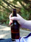 FOO BEV  MIS  SK   CWN02T0253D  VT HAND HOLDING BEER BOTTLESASKATOON                            06..© CLARENCE W. NORRIS           ALL RIGHTS RESERVEDALCOHOL;BEVERAGES;BOTTLES;COOL;FOOD;GLASS;HANDS;LIQUOR;OUTDOORS;PROPLE;PLAINS;PRAIRIES;SUMMER;SASKATCHEWAN;SASKATOON;SK_;VTLLONE PINE PHOTO                  (306) 683-0889