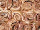 FOO MIS MIS  SK  CWN3D55353D   CLOSE UP OF CINNAMON BUNSSASKATOON                       0614© CLARENCE W. NORRIS      ALL RIGHTS RESERVEDBAKING;CINNAMON;FAIRS;FOOD;OUTDOORS;OVENS;PLAINS;PRARIES;SASKATCHEWAN;SASKATOON;SASKATOON_PRAIRIELAND_EXIBITION;SK_;SUMMERLONE PINE PHOTO              (306) 683-0889