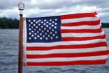 FLA MIS MIS  ON  BMM1001200DAMERICAN FLAG ON BOAT STERNLAKE JOSEPHMUSKOKA                           07/..© BEV MCMULLEN                ALL RIGHTS RESERVEDAMERICAN;BOATS;CENTRAL;COTTAGE;FLAGS;LAKE_JOSEPH;LAKES;MUSKOKA;ON_;ONTARIO;SUMMER;USALONE PINE PHOTO              (306) 683-0889