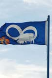 FLA MIS MIS  SK  WDS05B1213DX  VT   METIS FLAG SASKATOON                     ....© WAYNE SHIELS               ALL RIGHTS RESERVEDFLAGS;METIS;PLAINS;PRAIRIES;SASKATCHEWAN;SASKATOON;SK_;SUMMER;VTLLONE PINE PHOTO              (306) 683-0889